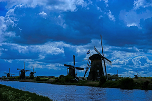 Night Arrives at the Windmills in Kinderdijk Netherlands by 1North
