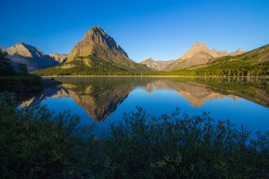 Morning Calm at Swiftcurrent Lake by John Foster