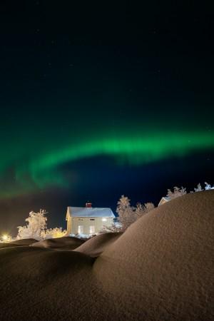 Winter- and aurora landscape by Jonas Sundberg