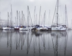 Yachts in the fog by Leighton Collins