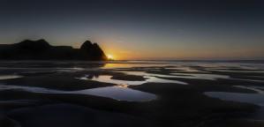 Dawn at Three Cliffs Bay by Leighton Collins