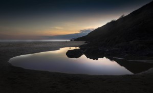 Rockpools at sunset by Leighton Collins