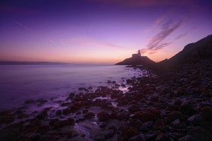 Daybreak at Mumbles lighthouse by Leighton Collins