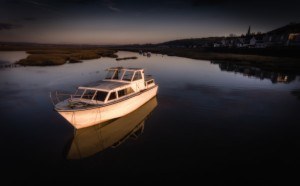 Penclawdd boat at dusk by Leighton Collins