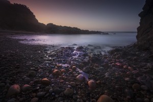 Pebbles on Rotherslade Bay by Leighton Collins