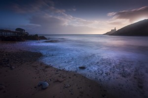 Sunrise at Mumbles beach by Leighton Collins