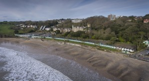 The beach chalets of Langland Bay by Leighton Collins