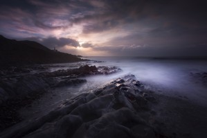 The rocky foreshore of Bracelet Bay by Leighton Collins