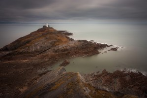 Calm seas at Mumbles lighthouse by Leighton Collins