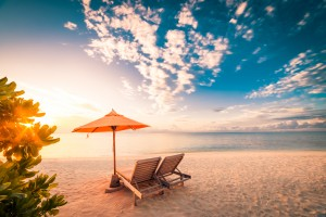 Amazing beach sunset  with sunbeds. Maldives by Levente Bodo
