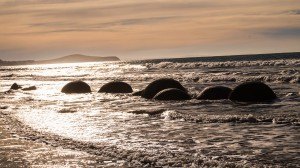 Moeraki Boulder Sun by Phano Smith