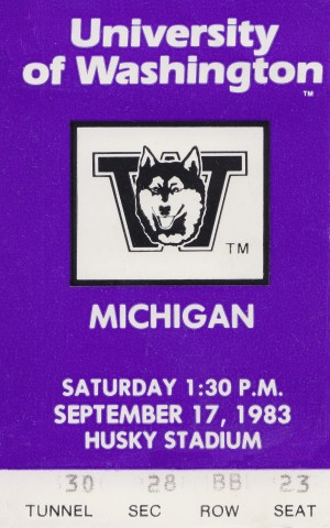 1983 washington huskies michigan wolverines college football ticket sports art gifts  by Row One Brand
