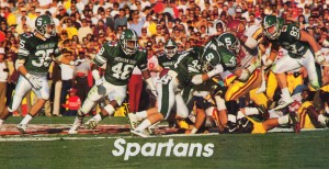 1988 michigan state usc rose bowl football action poster by Row One Brand