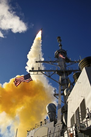 The Aegis-class destroyer USS Hopper launching a standard missile 3 Blk IA in Kauai Hawaii. by StocktrekImages
