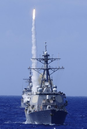 The guided-missile destroyer USS Benfold fires a surface-to-air missile off the coast of Hawaii. by StocktrekImages