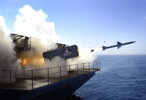 A RIM-7 Sea Sparrow missile launches from USS Abraham Lincoln. by StocktrekImages