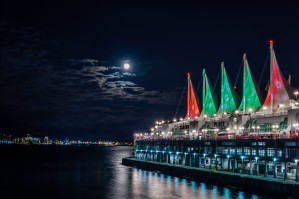 A cruise ship pier with colorful sails on a moonlit Christmas night by Viktor Birkus