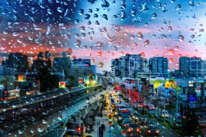 night city behind a glass with raindrops by Viktor Birkus