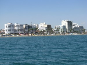 Coast view with modern buildings and hotels of Larnaca in Cyprus by Vlad Radulian