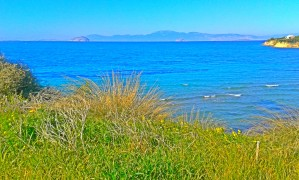 Mountain view including sea and several islands along the coast of Aegina in Greece by Vlad Radulian