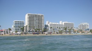 Sunny beach with large hotels in Larnaca, Cyprus by Vlad Radulian