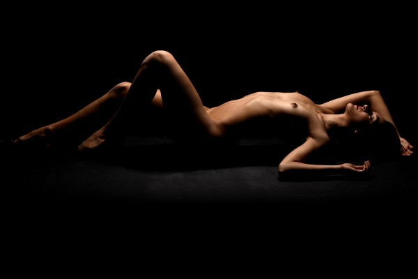 Nude_bodyscape_young_woman_laying_sensual_naked_black_06 by Alessandrodellatorre