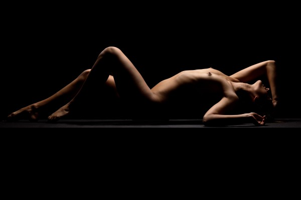 Nude_bodyscape_young_woman_laying_sensual_naked_black_07 by Alessandrodellatorre
