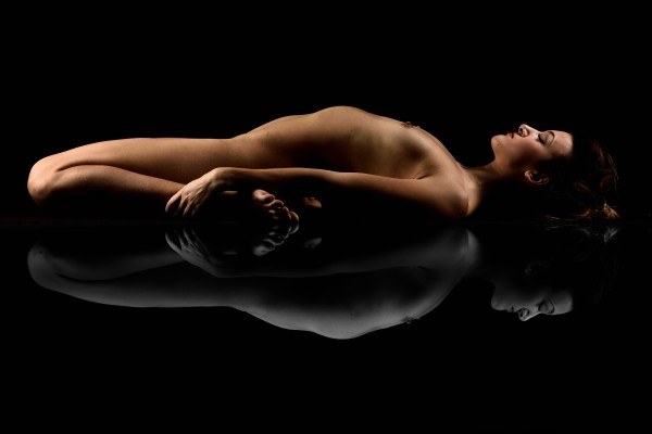 nude_woman_fine_art_laying_down_naked by Alessandrodellatorre