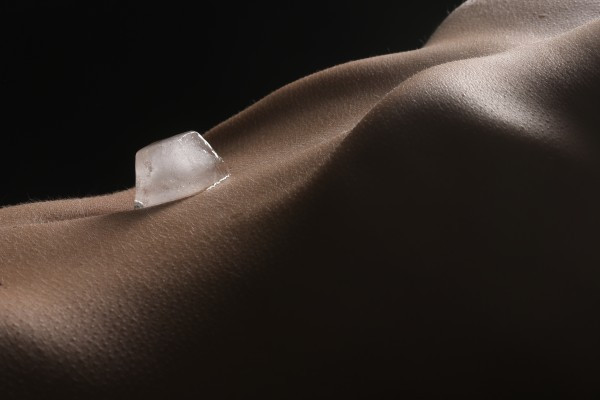 bodyscape_nude_woman_ice_cube_belly_isolated by Alessandrodellatorre