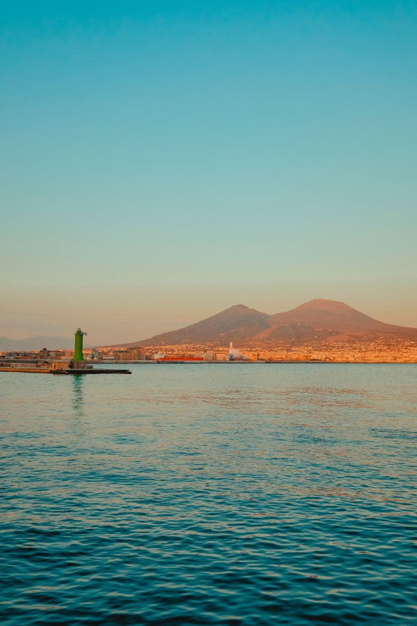 Vesuvio and Lighthouse at sunset by AngelaSorrentino
