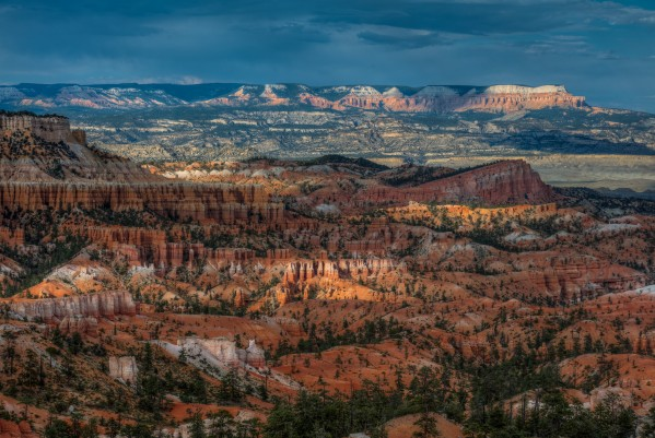 POCKETS OF LIGHT AT BRYCE CANYON-UTAH  by Bill Sherrell