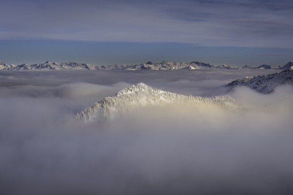 mountain tip  coming through the inversion  by Billy Stevens media