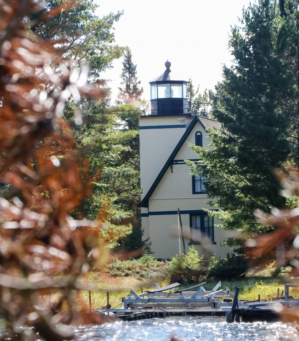 Lighthouse Through the Woods by Bob Vogt