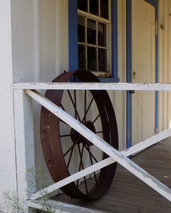 Wagon Wheel on Porch by Castle Green Enterprises