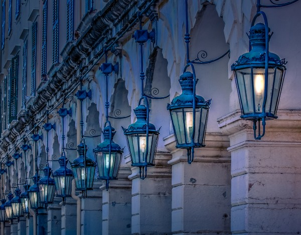 Blue Lamps on Columns at Night by Darryl Brooks