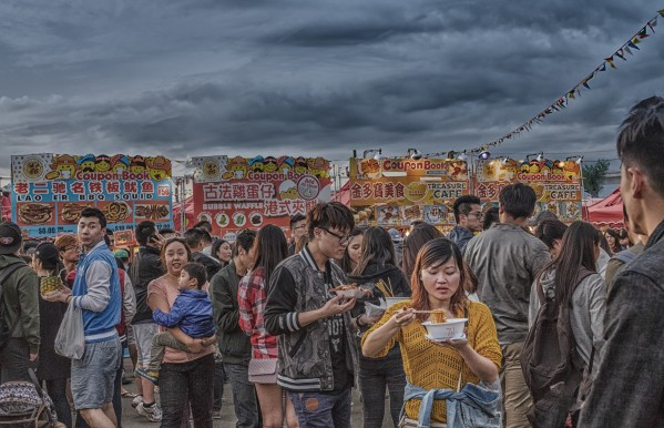 Eating Noodles at Night Market by Darryl Brooks