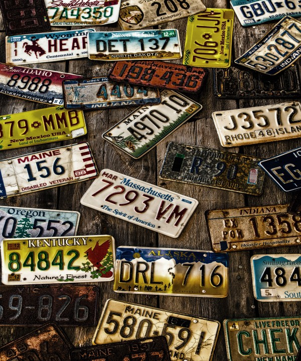 License Plates on Old Wall by Darryl Brooks