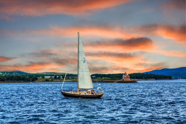 Sailboat and Lighthouse by Darryl Brooks