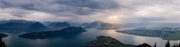 Panorama view of Quatre Cantons Lake under a storm by Em Campos