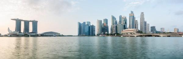 Panorama of Singapore skyline at sunrise by Em Campos