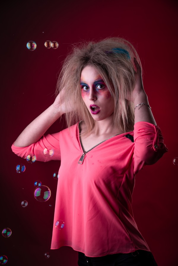 Attractive young girl with disheveled hair  by Faces Studio