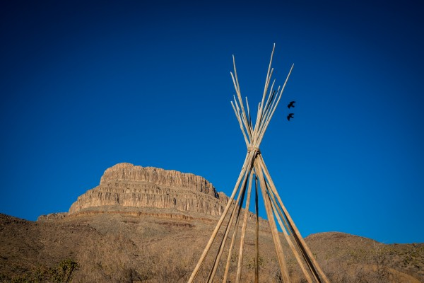 view of the american west with a teepee wood shape in Arizona by Francois Lariviere