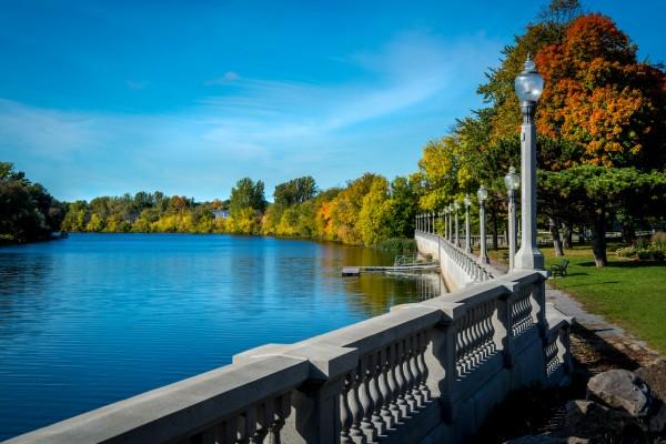 Walk along the Yamaska river in Saint-Hyacinthe in fall by Francois Lariviere