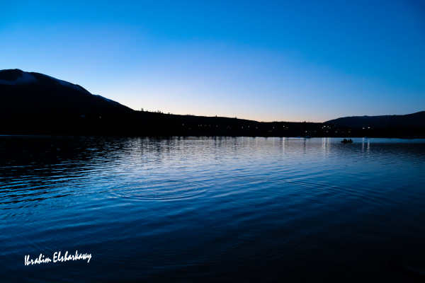 Lake in the Mountains during twilight by Ibrahim Elsharkawy