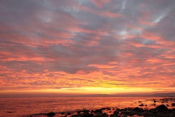 Dramatic sunset at a small bay by Pavel Gospodinov
