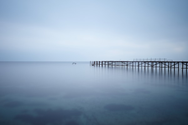Abandoned pier in the sea at sunset by Pavel Gospodinov