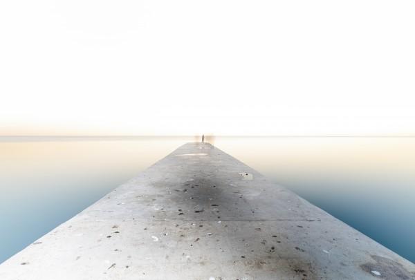 Man fishing on a pier by Pavel Gospodinov