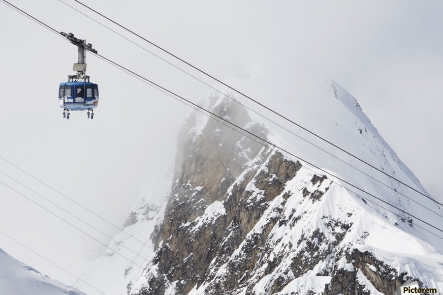 Scenic view of the Titlis Rotair revolving circular tram at Engelberg Resort in Switzerland  Print