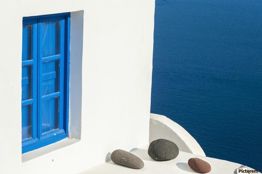 Whitewash building with blue trimmed window along the Aegean sea; Oia, Santorini, Greece  Print