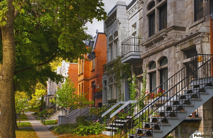 apartment buildings along city street montreal quebec canada